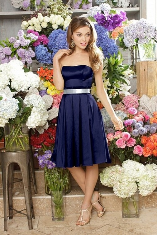 a strapless navy bridesmaid dress with a silver sash and silver shoes for a bright and chic look