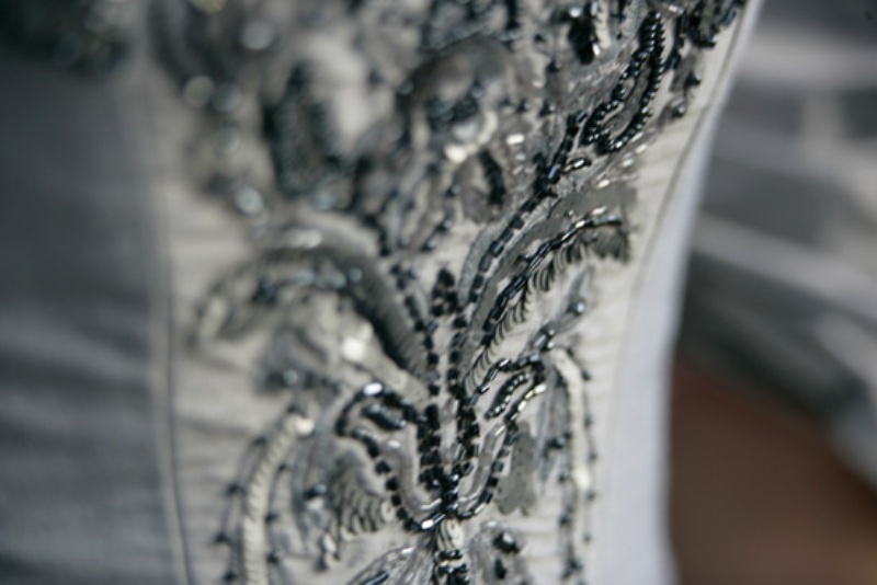navy and silver beading on the wedding dress will help you incorporate your colors into your look