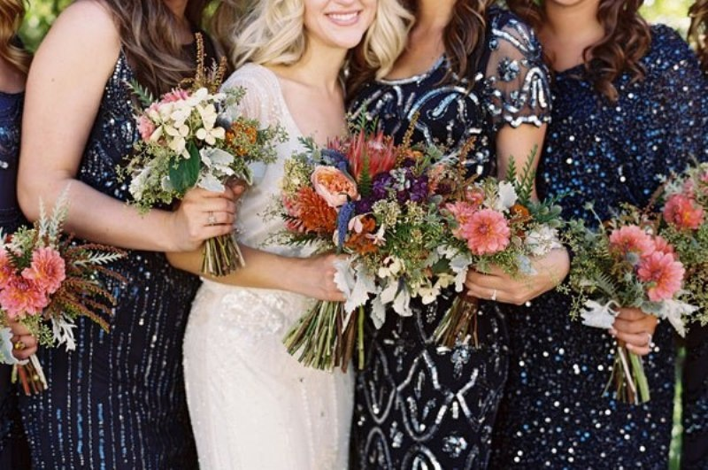 mismatching sparkling navy and silver bridesmaid dresses