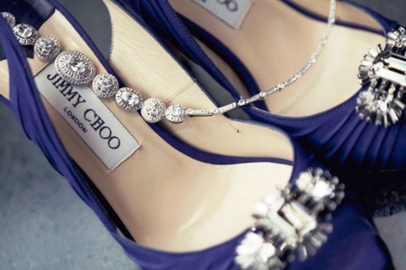 navy Jimmy Choo shoes with silver embellishments and matching silver jewelry for the bride and bridesmaids