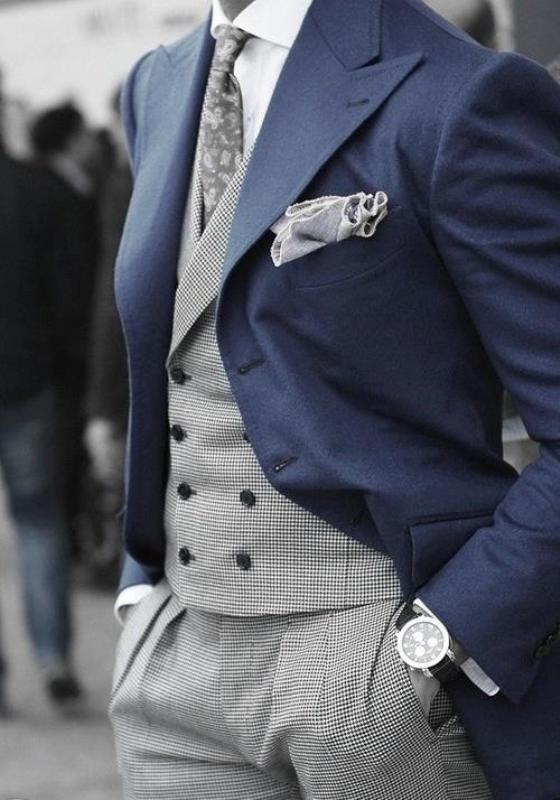 a super elegant groom's look with a morning suit   a navy jacket, a grey suit, a white shirt and a printed tie