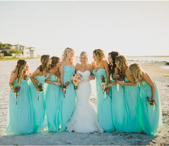 neon blue strapless maxi bridesmaid dresses with draped bodices for a blue beach wedding