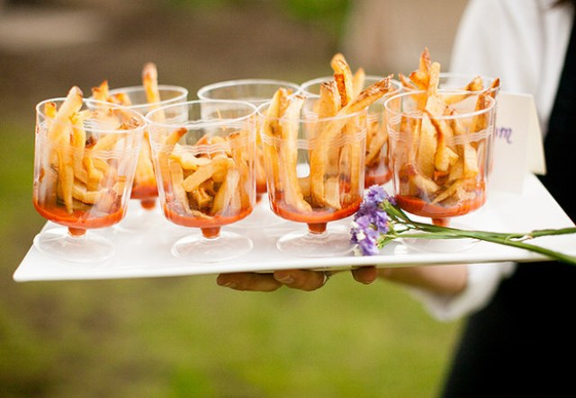 French fries with tomato sauce served in elegant cups are a cool idea