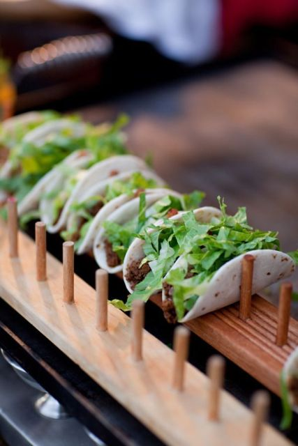 mini tacos with fresh greenery are ideal for serving at the wedding, for appetizers and for late-night snacks