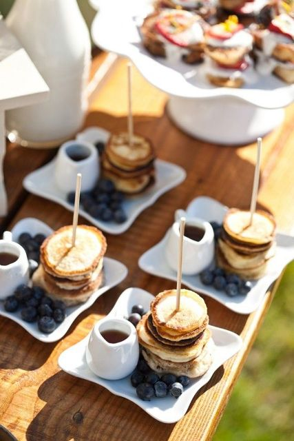 mini pancake stacks with blueberries and honey are amazing for brunch weddings or for those who have a sweet tooth