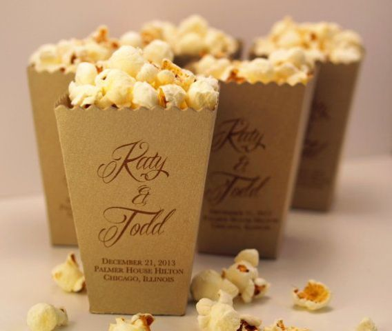 boxes with fresh popcorn   salted or sweet   can be a nice snack idea for a wedding