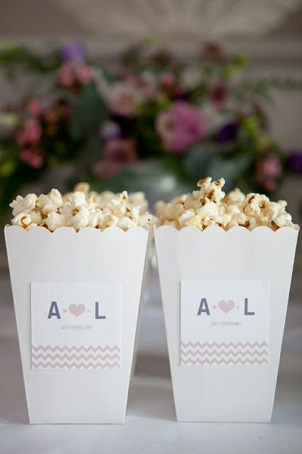 boxes with popcorns are personalized with monograms