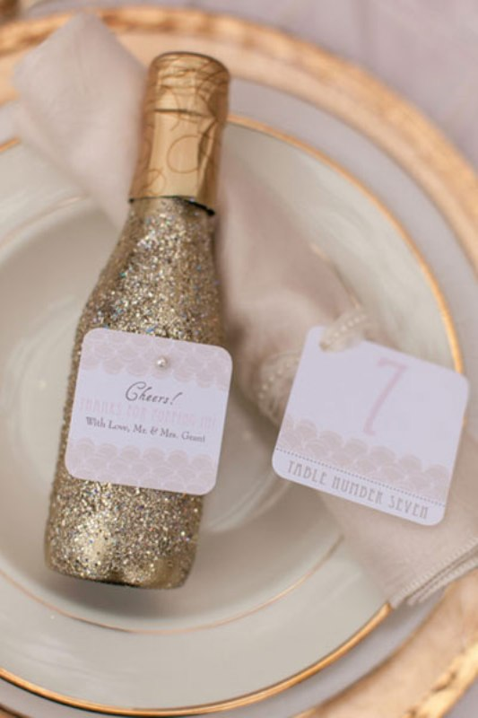 mini gold glitter champagne bottles are very cool Christmas, NYE or just winter wedding favors