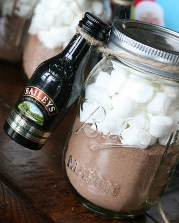 hot cocoa mix in a jar and a mini Bailey's bottle is a great and delicious wedding favor for a winter or Christmas celebration