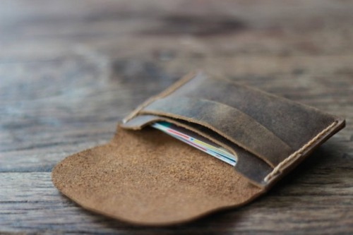 a brown leather case for credit cards is always a good idea - each person will appreciate it