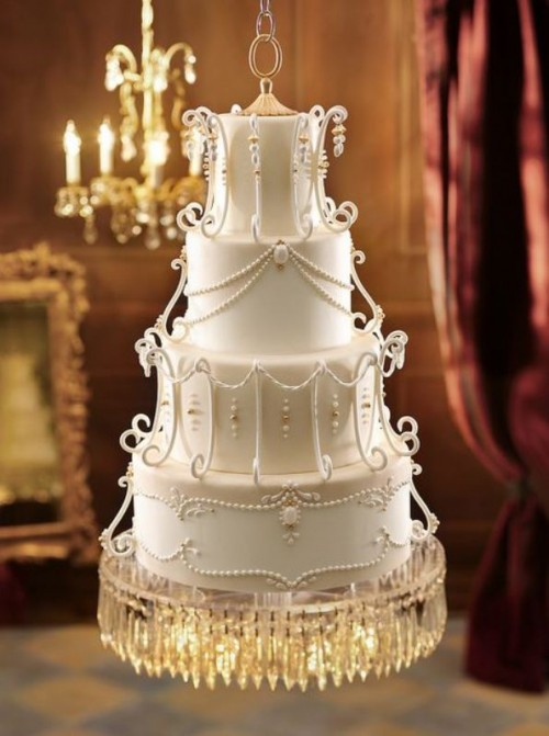 a white wedding cake with patterns, beads, rhinestones, crystals looks very refined and very chic