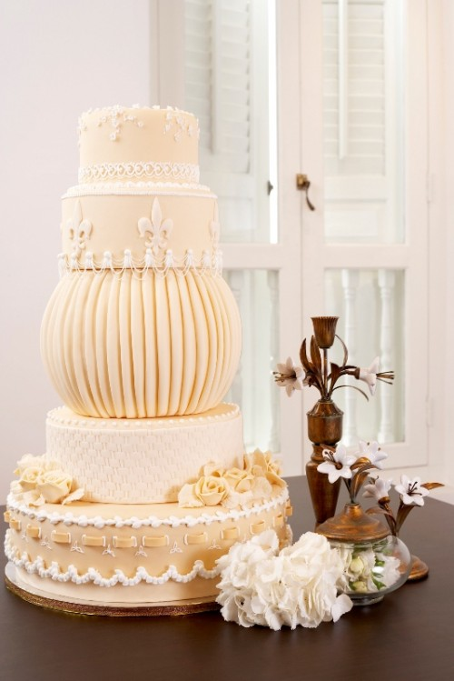 a creative neutral wedding cake with multiple tiers, lace decor and sugar blooms is a whimsy idea for a vintage wedding