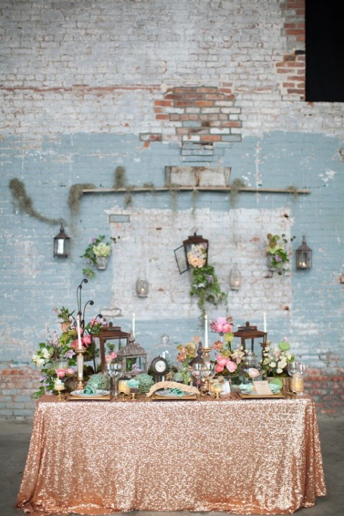 a glam spring wedding reception with greenery, pastel and bright blooms, candle lanterns