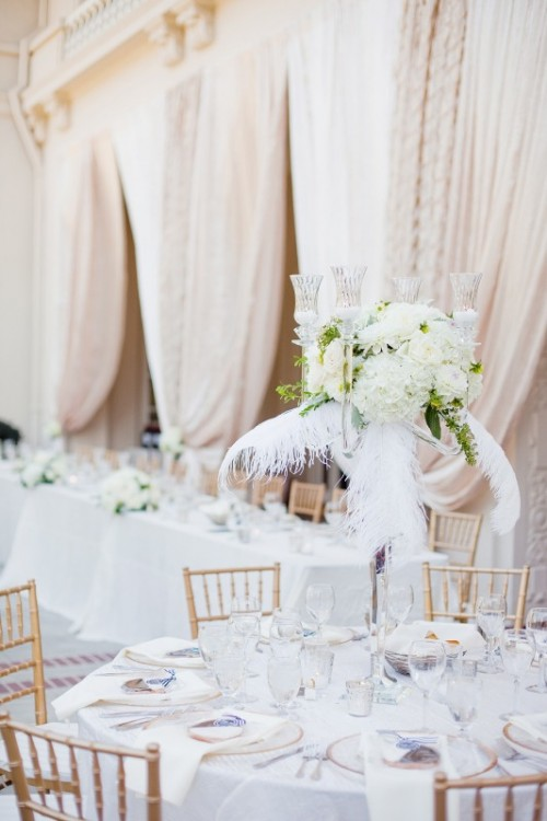 a refined neutral spring wedding reception with white blooms, feathers, touches of gold for a chic feel