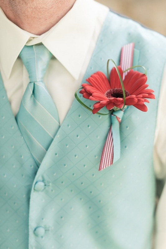 a mint green waistcoat plus a matching striped tie, a bold red boutonniere for a retro groom's look