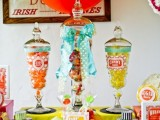 a colorful candy bar in jars with colorful bows and ribbons is ideal for a retro wedding