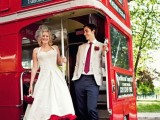 a retro-inspired midi dress with wide straps, a red underskirt and neutral shoes with red hearts for a retro wedding