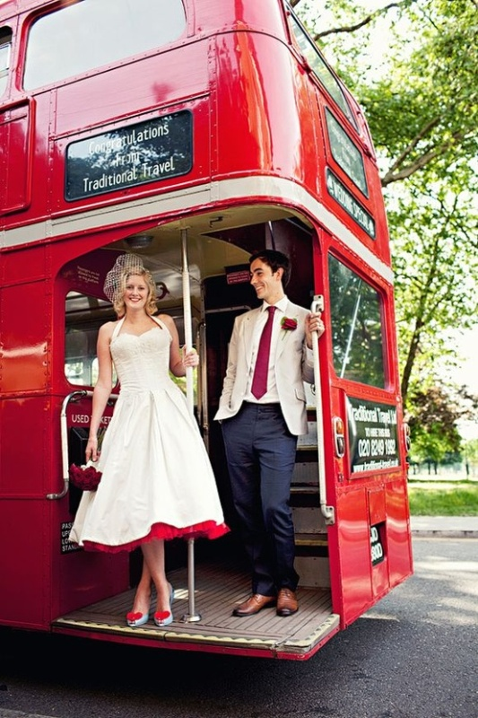 a retro inspired midi dress with wide straps, a red underskirt and neutral shoes with red hearts for a retro wedding