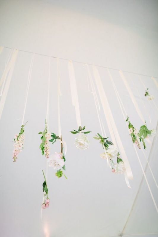 some neutral blooms hanging on ribbons will give your reception an ethereal and delicate look, perfect for spring or summer