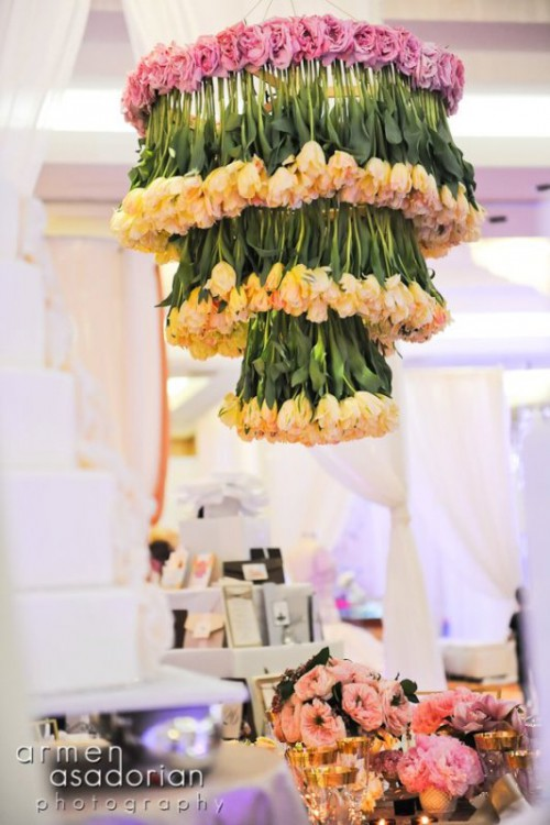 a fantastic floral chandelier of neutral tulips and pink roses on top is a chic and bold idea