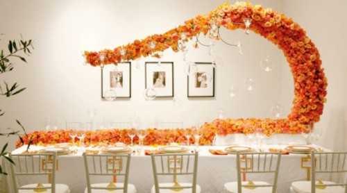 bold orange blooms going along the table and curling up over it for a cool and bold look that catches an eye