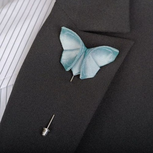 an ice blue paper butterfly boutonniere is a lovely accessory for a winter groom's look