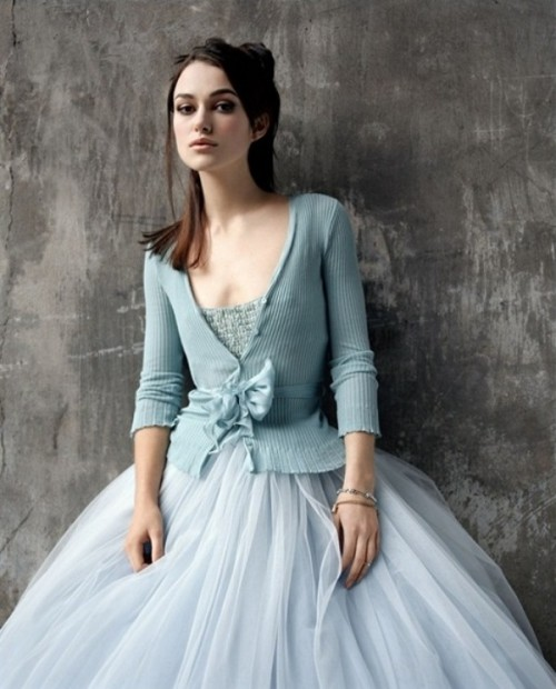 an ice blue top and a matching cardigan with a tulle skirt make up a chic and beautiful winter bridal look