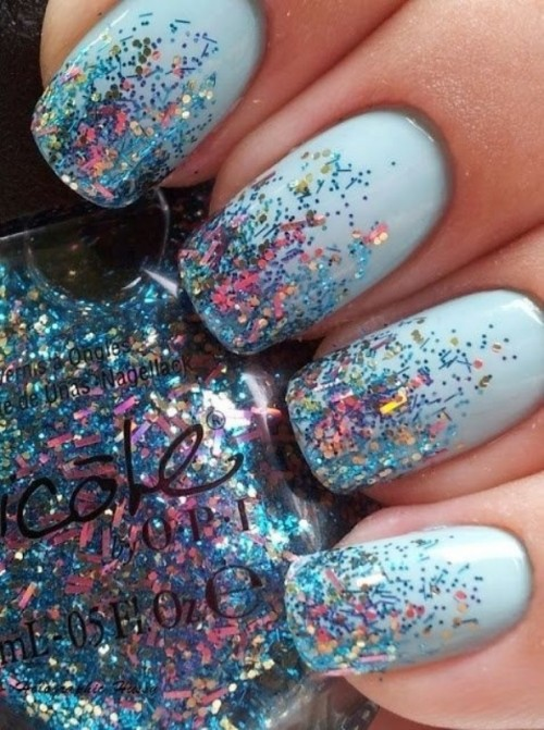 an ice blue winter wedding manicure with confetti is a nice and bold idea for a bride or bridesmaid