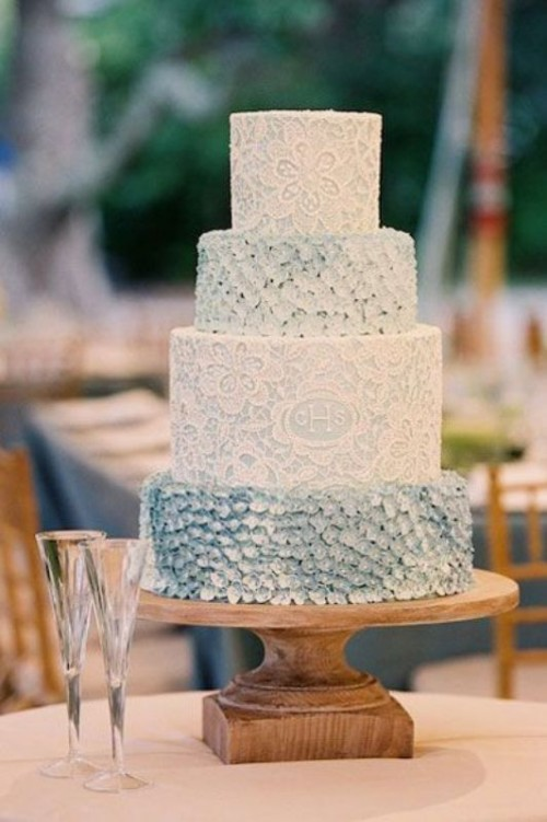 an ice blue and white patterned and textural wedding cake is a nice fit for a refined vintage wedding in winter