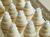 mini wedding cakes with ice blue glazing and white frosting are gorgeous for winter weddings