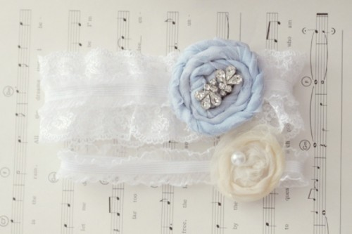 white lace garters with neutral and ice blue fabric blooms and beads look amazing