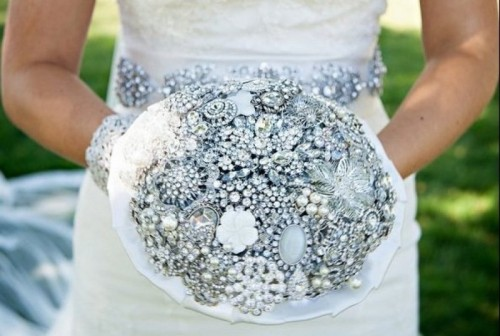 a silver and ice blue brooch wedding bouquet will be a gorgeous idea, match your embellished sash to it