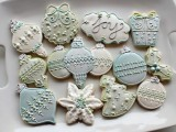 ice blue, white and green Christmas themed wedding cookies for your dessert table
