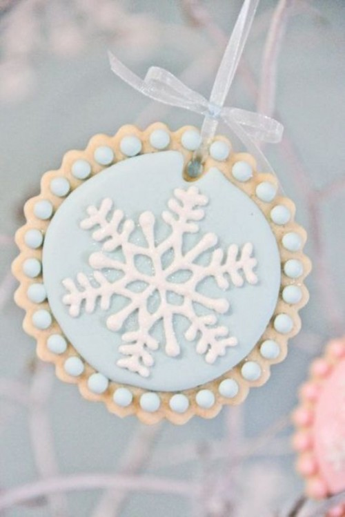 an ice blue snowflake cookie will be a fit for your dessert table or a cool winter wedding favor