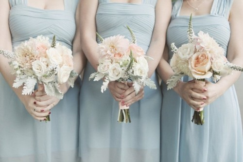 ice blue bridesmaid dresses with thick straps and draped bodices for a frozen winter wedding