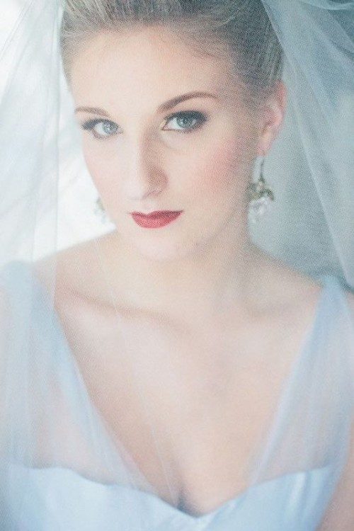 an ice blue wedding dress with a deep neckline and a matching veil for a frozen queen bridal look