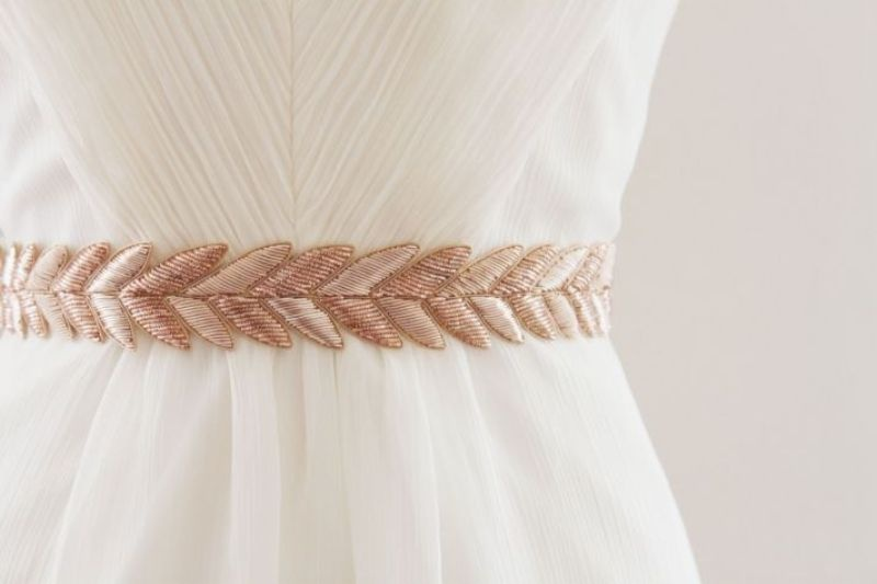 an embroidered leafy rose gold sash will accent your wedding dress the best way possible