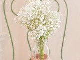 a rose gold glitter jar with baby's breath for a romantic wedding centerpiece or just decor