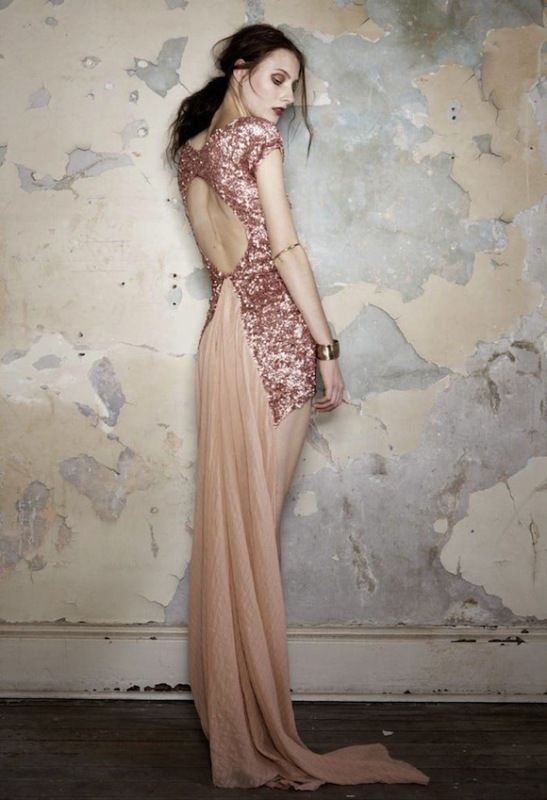 a jaw dropping blush and rose gold sequin wedding dress with a cutout back and a train is very beautiful and romantic