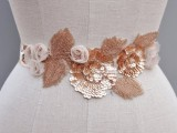 a beautiful and romantic floral and leaf rose gold sash with beading, sequins and fabric is very lovely