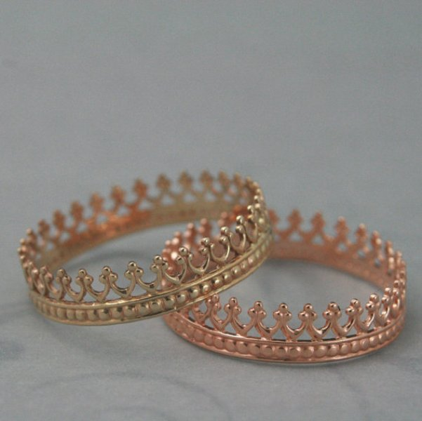 a gold and rose gold crown like wedding ring for a couple