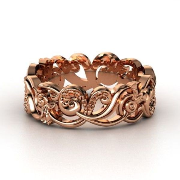 a statement rose gold patterned ring will make your wedding look wow