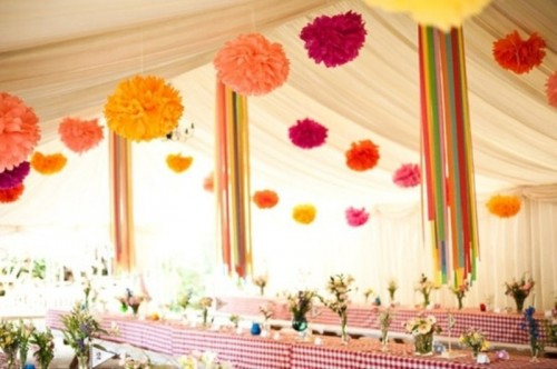 colorful paper pompom garlands over the reception space will make it feel and look more festive
