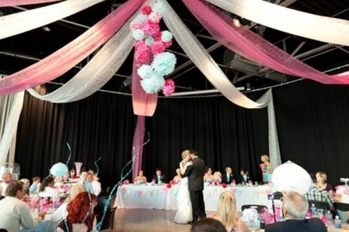 pink and white fabric ribbons and matching paper pompoms under the dome for lovely and chic decor