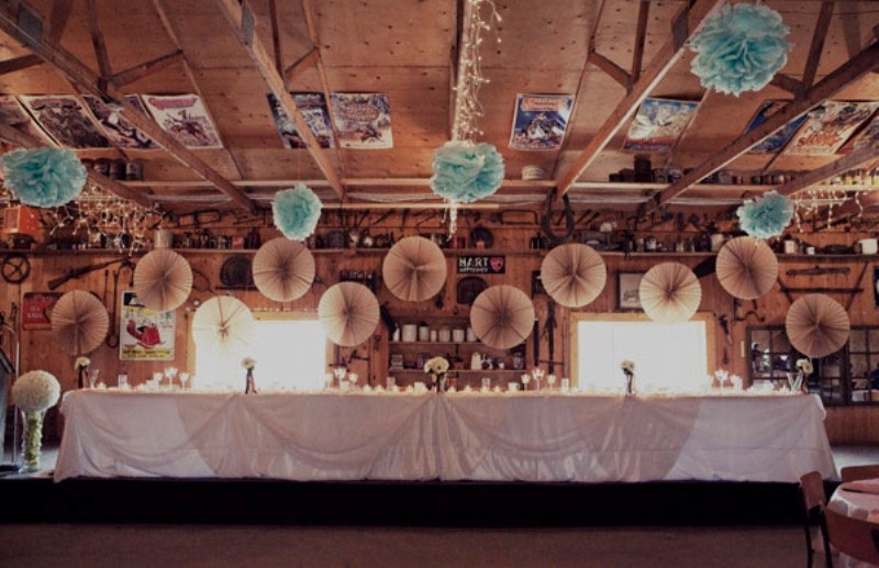 blue paper pompoms and blush paper fans are budget friendly decor for the space