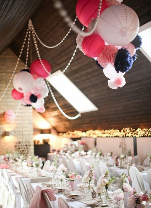 bead garlands, large colorful paper lamps and lots of colorful paper pompoms will accent your reception space easily without breaking the bank