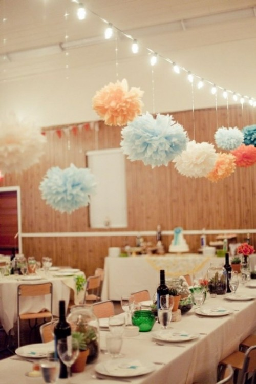 pastel, red and white paper pompoms hanging on lights over the space will create a festive feel in the venue easily
