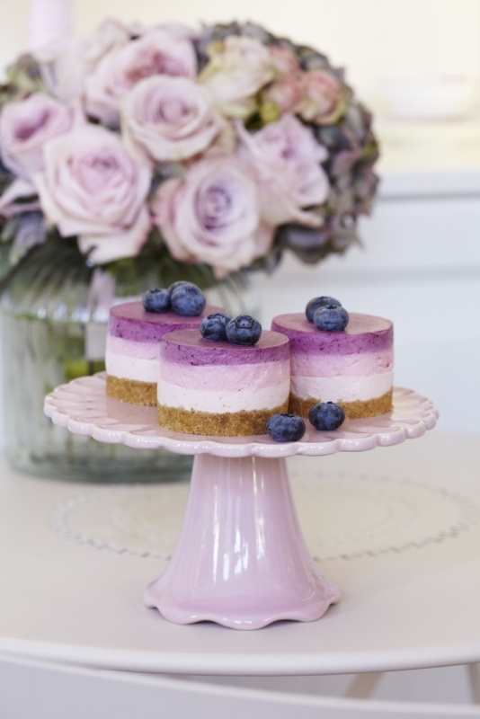 lilac colored mini cheesecakes topped with blueberries are nice desserts for a lilac wedding