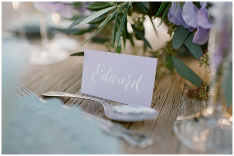 a lavender colored place card with calligraphy is a chic and stylish idea