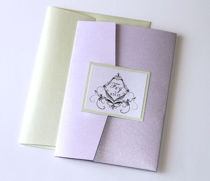 a neutral and lilac wedding invitation with an envelope is a chic and stylish idea to go